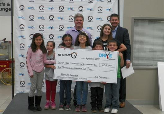 HOPE receives grant check from Groove Auto.
