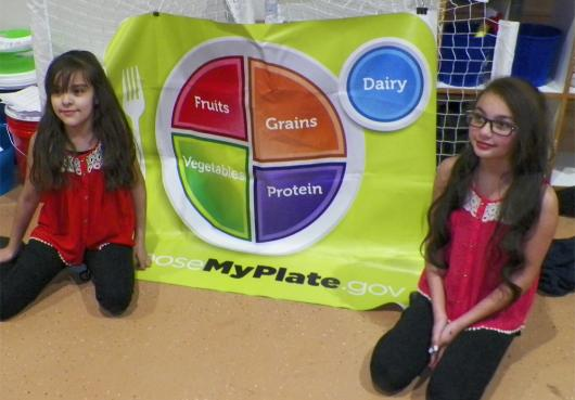 HOPE students in front of the nutrition poster