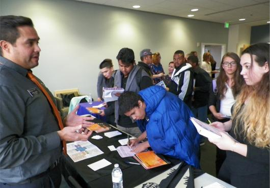 Students visit with colleges at College Fair