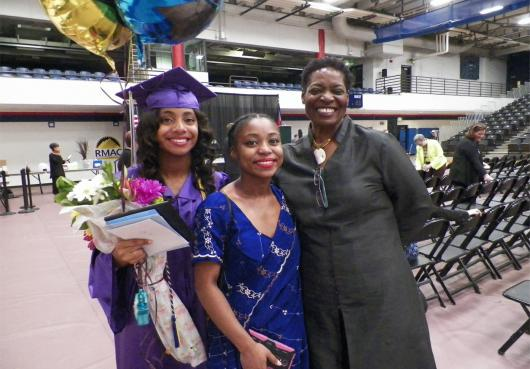 A HOPE family smiles for the camera after Graduation
