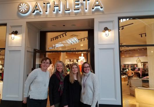 HOPE official pose with officials of Athleta during a donor thank you event