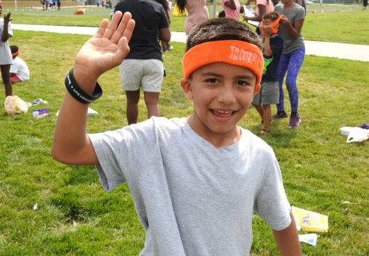 HOPE student waves at the camera at Field Day 2017.