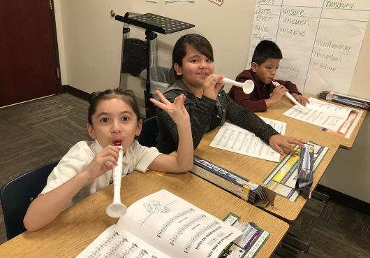 Students practicing on their recorders during music class