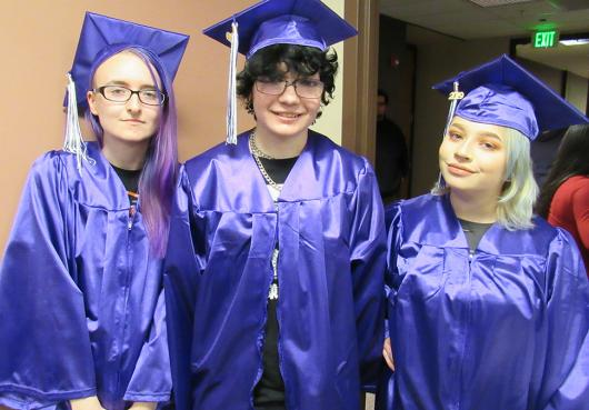 HOPE graduating seniors pose in their cap and gown
