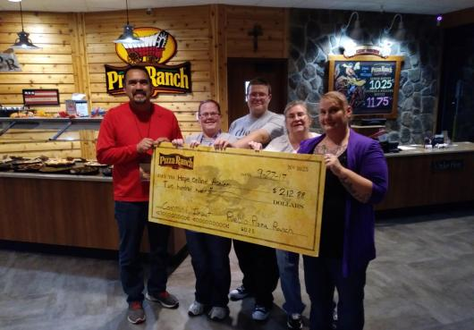 Pizza Ranch presents check to HOPE Learning Center during fundraising night.