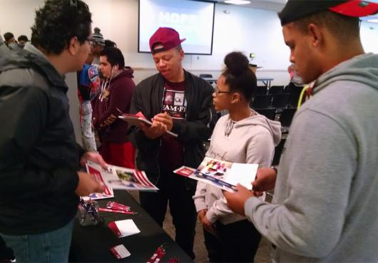 High School Students talk to colleges at the College and Career Fair 2017.