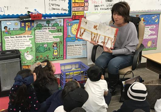 Students enjoying listening a a reader during Literacy Day 2019
