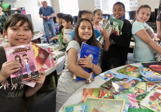 HOPE students excited about the free books they received from the local Kiwanis Club